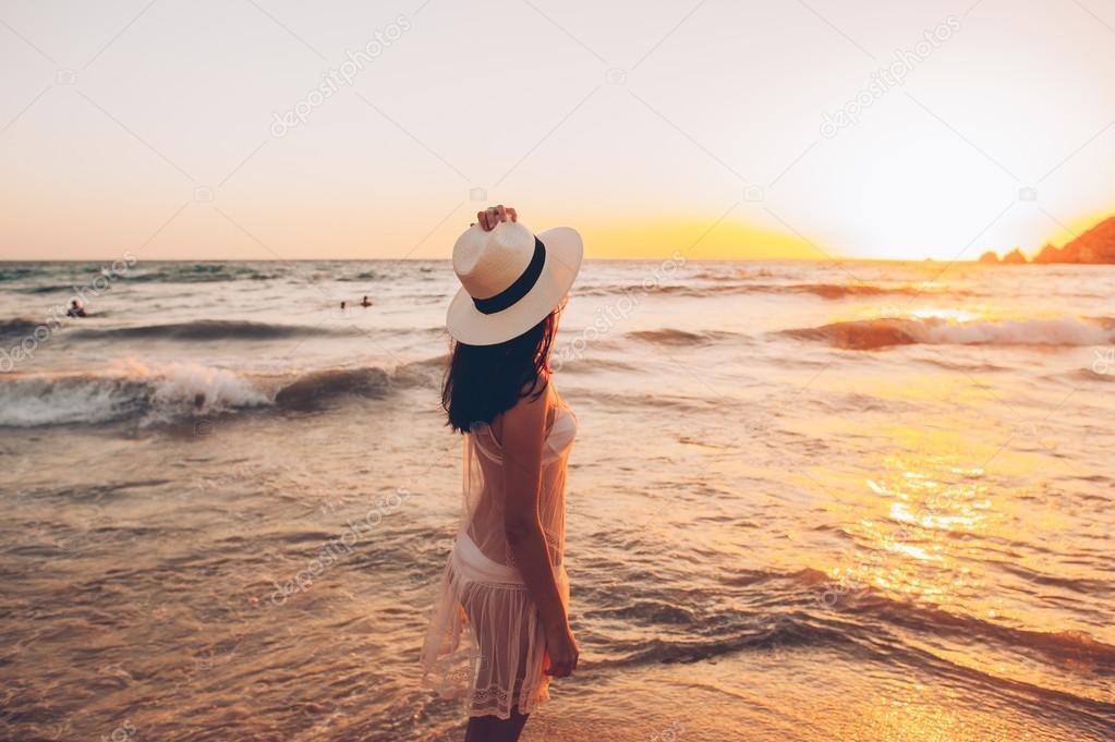Woman walks along beautiful seashore — Stock Photo © Photo_life ...